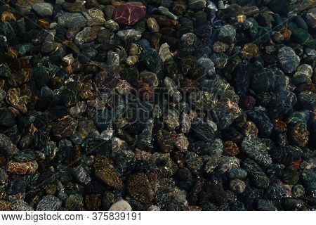 Sea Pebbles Under Clear Water Near The Shore With Reflection Of Sunlight. Screensaver, Design Pictur