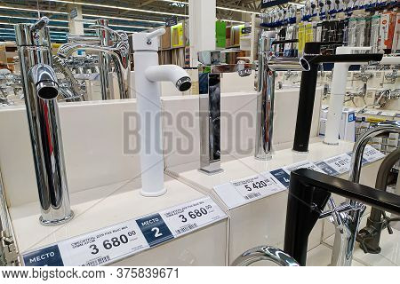 Moscow, Russia - August 17, 2019: Water Taps On The Rack In A Building Materials Hypermarket