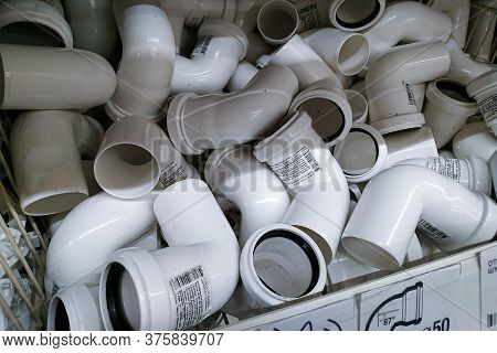 Moscow, Russia - August 17, 2019: White Plastic Corner Connectors For Plumbing Pipes On The Rack In