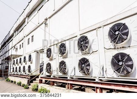 Air Conditioning Systems Mounted On An Exterior Supermarket Wall