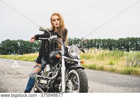 Beautiful Girl Biker Sitting On The Motorcycle.