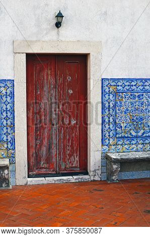 The Old Door And Wall Is Lined With Tiled Azulejo On The Terrace Of The Monastery Of San Vicente De
