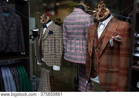 Beautiful Male Stylish Expensive Suits With Bow Tie On A Mannequin. Mannequins In The Wind Of A Mens