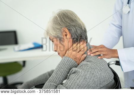 Senior Woman With Neck Pain In The Medical Office, Sick Senior Woman With Back Neck And Shoulders Pa