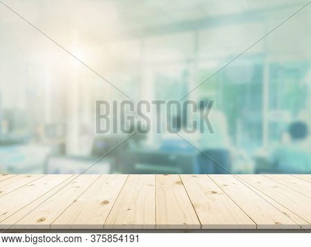 Office Workplace With Laptop And Smart Phone On Blank Wood Table. Business Blurred In The Workplace