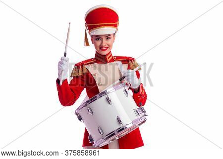 Drummer In A Red Uniform Drums On A Drum, Show Program And Celebration.