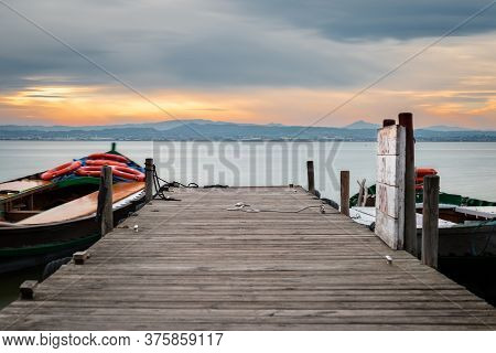 Jetty And Small Wooden Boat At Dusk In The Albufera In Valencia, A Freshwater Lagoon And Estuary In