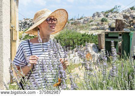 Beautiful Blonde Young Female Traveler Wearing Straw Sun Hat Enjoying Summer On Mediterranean Cost S