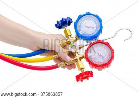 Hand Holding Gauge Station, Pressure Gauge, Manometer On White Background Isolation