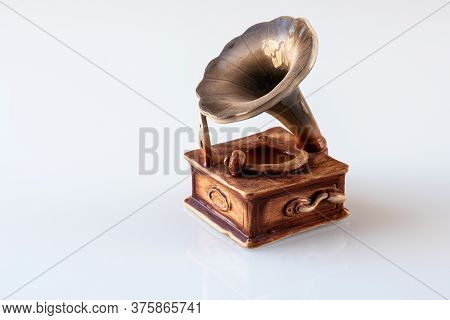 The Decorative Statuette Of Gramophone On White Background