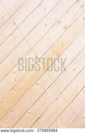 Diagonal Wooden Lining Background. Bleached Wooden Texture. New Wooden Boards On Wall. Close-up. Str