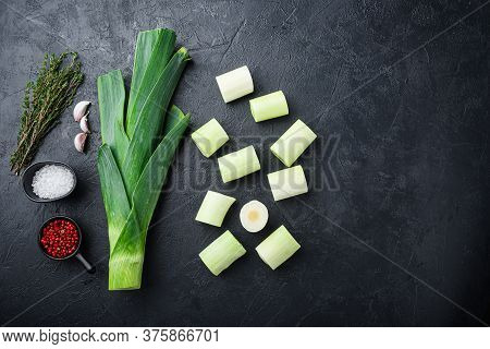 Chopped Green Leeks Oninon Uncooked With Herbs Ingredients , On Textured Black Background Top View W