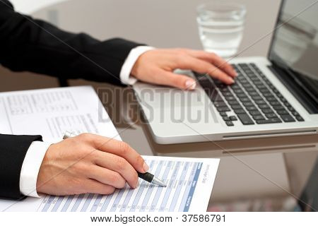 Female Hands Reviewing Documents.