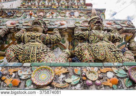 Stunning View Of Demon Guardians Supporting Wat Arun Temple, Bangkok, Thailand