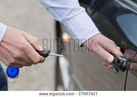 Man Unlocking Car Door.