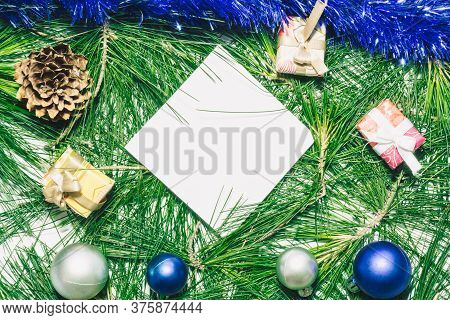 X-mas Background With Blue Decoration, Christmas Balls, Presents, Pinecones And Green Pine Leaves. D