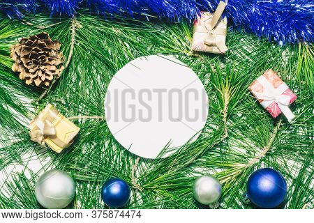 X-mas Background With Blue Decoration, Christmas Balls, Presents, Pinecones And Green Pine Leaves. R