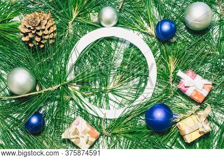 X-mas Background With Christmas Balls, Presents, Pinecones And Green Pine Leaves. Empty Circle Copy