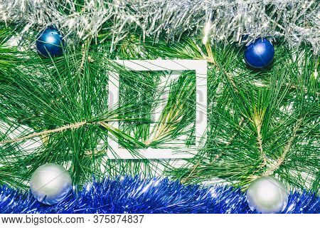X-mas Background With Blue And Silver Decoration, Christmas Balls On Green Pine Leaves. Empty Square