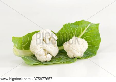 Close-up Of Delicious White Cauliflower On A Leaf Illustrating A Healthy Lifestyle Isolated On White