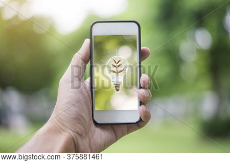 Close Up Man Hand Using Smartphone With Ecology Sign, Save Earth Concept