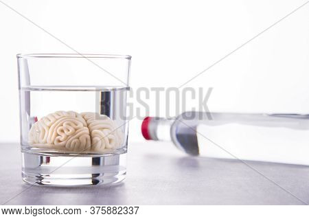 Alcohol Addiction Concept. Brain Drowned In Alcohol. Reduce Iq After Drinking Alcohol