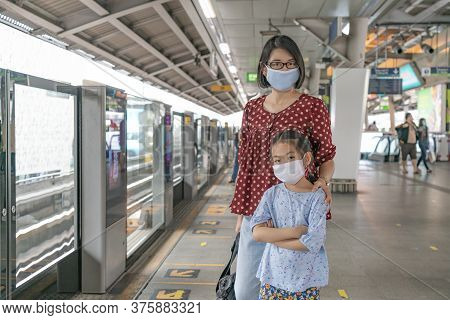 Bangkok, Thailand - Jul 07, 2020 : Portrait Of Asian Mother And Little Daughter On Sky Train Station