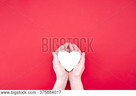 Woman Holding Decorative Heart On Red Background, Top View. Space For Text