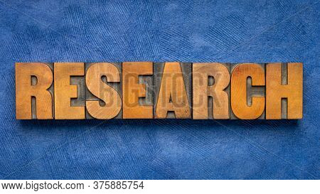 research word abstract in vintage letterpress wood type, investigation, study, business and science concept