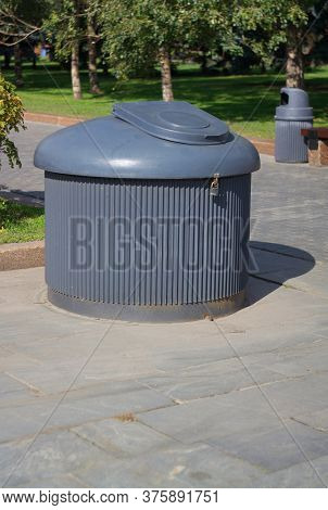Dustbin In Park At Dry Sunny Summer Day
