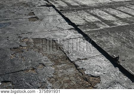 Bitumen Flat Roofing Renovation, Background Texture Of Removed Damaged Insulation Layer Of Roof