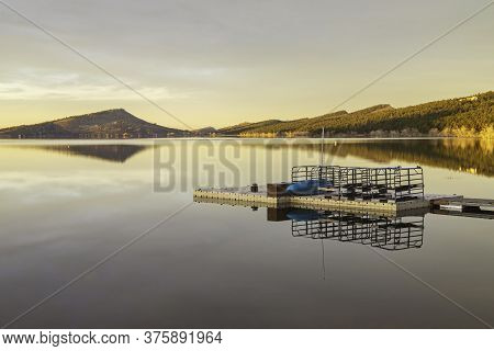 Soft Light Sunrise Glow On A Mountain Lake Boating Dock