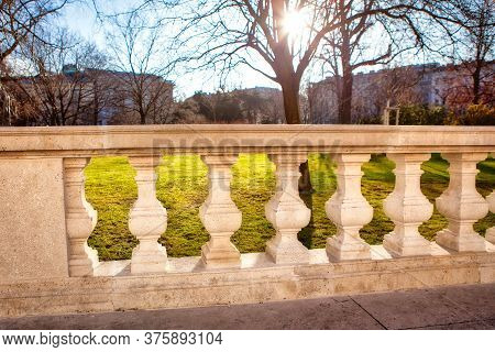 Marble Balustrade And Sunshine In The Spring Park