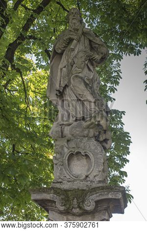 Old Statue Of St. Prokopa Standing On The Square In Front Of The Sanctuary Of The Blessed Virgin Mar