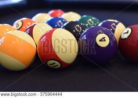 Black Billiard Table, Playing Snooker Pool 8Ball - Close-up Shot Of A Man Playing Billiard
