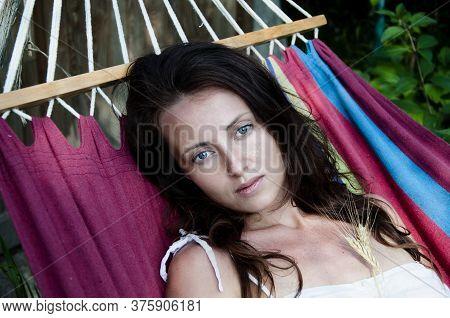 Woman In Hammock Portrait. Woman Lying In Hammock On Nature. Lady Laying On Hammock Enjoying Summer.