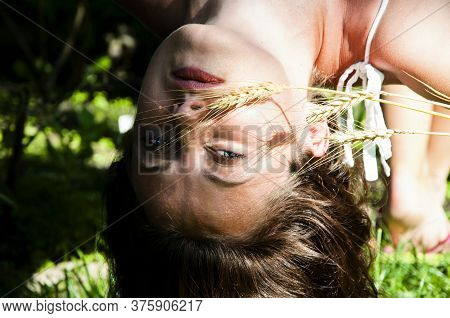 Beautiful Young Brunette Woman Hanging Upside Down. Blue Eyed Girl Upside Down. World Inside Out. Th