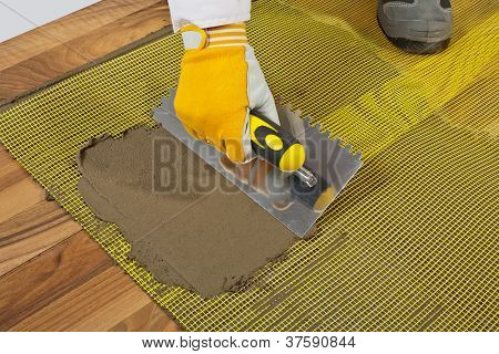 Tile Adhesive On Wooden Floor With Reinforcement Mesh