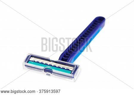 Blue Plastic Razor And Shaving Blade Isolated On White Background. New Disposable Razor Blade. Close