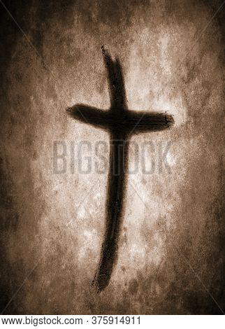 Ash Cross Drawn On Paper With Finger And Digitally Aged On Mottled Brown Sepia Background - Lent Ash