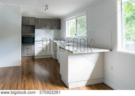 New Kitchen In Renovated House With Laminated Timber Flooring