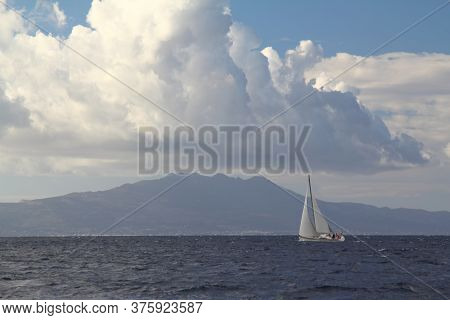 Sailing Ship Yachts With White Sails In Race The Regatta In The Open Sea