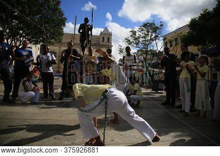Salvador, Bahia / Brazil - Nov. 20, 2019: Capoeiristas Of The Bahia Ginga Group Perform At Pelourinh
