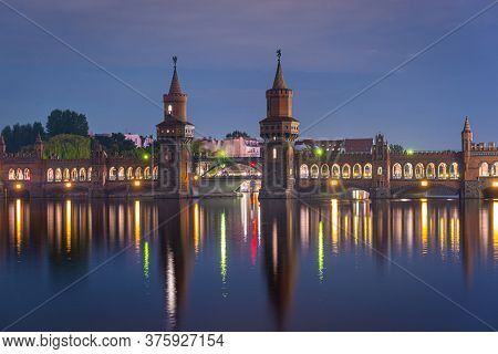 Oberbaum Bridge over the Spree River in Berlin, Germany at night.