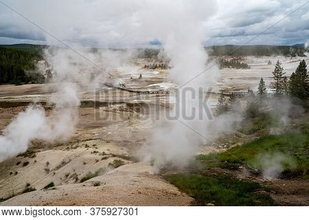 View Of The Steaming Geysers And Thermal Features In Norris Geyser Basin Boardwalks