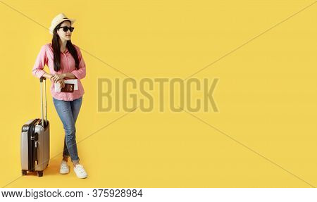 Asian Women Long Hair Wear Straw Hat With Black Ribbon, Sunglasses In Hand Holding Passport Book And