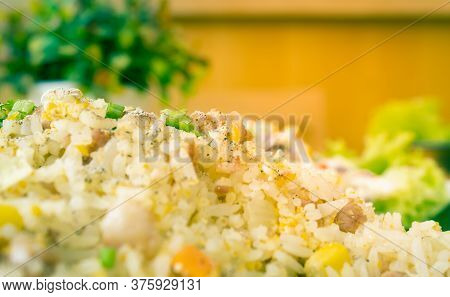 Thai Sour Pork Fried Rice And Salad In Dish With Natural Light In Close Up View On Left Frame In Vin