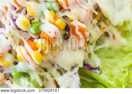 Vegan Or Vegetarian Salad With Mayonnaise Topping On Left Frame Include Carrot And Tomato And Corn A