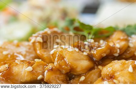 Fried Chicken With Garlic And Pepper In Dish With Natural Light In Zoom View