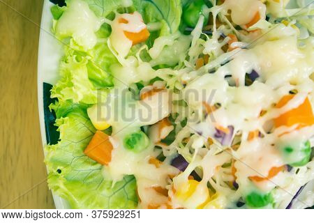 Healthy Salad Include Carrot And Corn And Peas And Tomato And Cabbage With Mayonnaise Topping With N